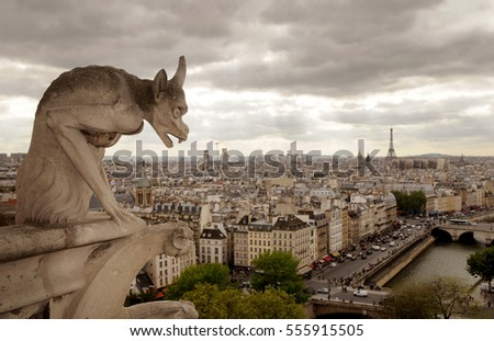Famous Gargoyle on Notre Dame Cathedral and city of Paris, France