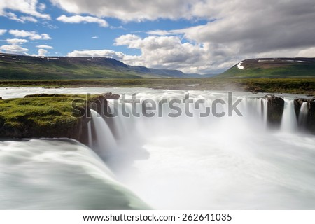 Famous Godafoss waterfall captured with long exposure on a summer day, North Iceland