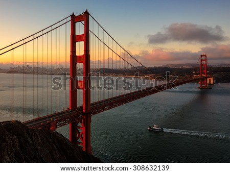 Famous Golden Gate Bridge in San Francisco at sunrise, California - stock photo