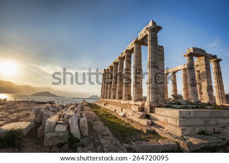 Famous Greek temple Poseidon,  Cape Sounion in Greece - stock photo