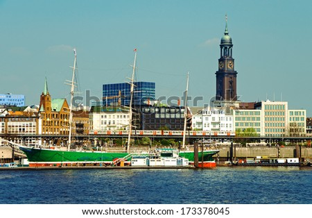famous hamburg harbor with michel church and sailing ship rickmer rickmers - stock photo