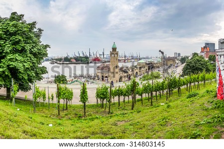 Famous Hamburger Landungsbruecken with harbor and ships on Elbe river, St. Pauli district, Hamburg, Germany