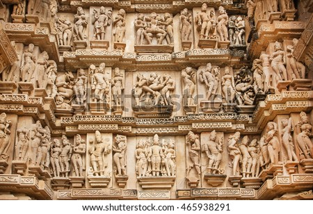 Famous historic monumant with erotic theme on sculptured wall of indian temple of Khajuraho. UNESCO Heritage site, built between 950 and 1150 in India, belong to two religions - Hinduism and Jainism.