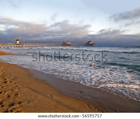 Famous Huntington Beach pier during a Southern California sunset. - stock photo