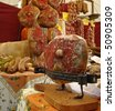 famous italian ham on traditional market,Tuscany, Italy, Europe, - stock photo