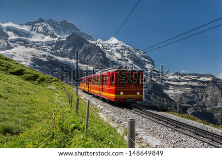 Famous Jungfrau Bahn with Beautiful Mountain View in Sunny Day  - stock photo