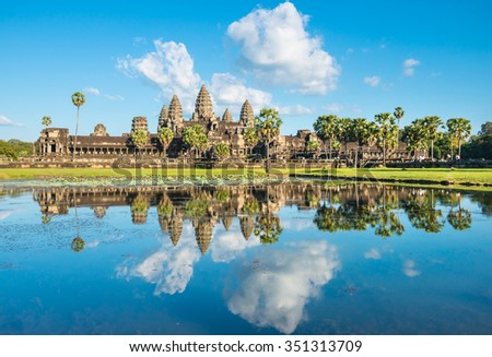 Famous khmer Angkor Wat temple in Cambodia with water reflection - stock photo