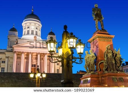 Famous landmark in Finnish capital: scenic night summer view of Senate Square with Lutheran cathedral and monument to Russian Emperor Alexander II - stock photo