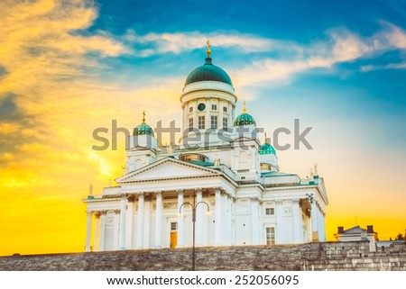 Famous Landmark In Finnish Capital: Senate Square With Lutheran Cathedral And Monument To Russian Emperor Alexander Ii At Summer Sunset Evening With Dramatic Sky - stock photo