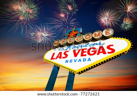 Famous Las Vegas Welcome Sign at sunset with firework in the background. - stock photo