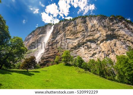 Famous Lauterbrunnen valley with gorgeous waterfall and Swiss Alps in the background, Berner Oberland, Switzerland, Europe.