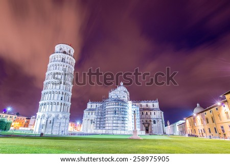 Famous leaning tower of Pisa during evening hours - stock photo