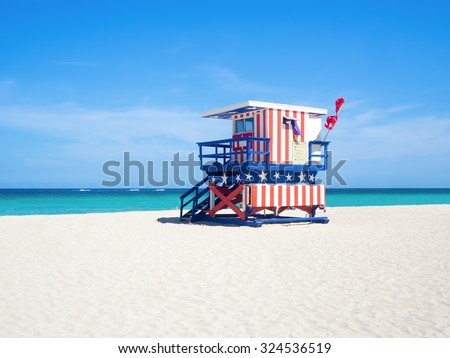 Famous lifesaver hut with the colors of the American flag at South Beach in Miami - stock photo