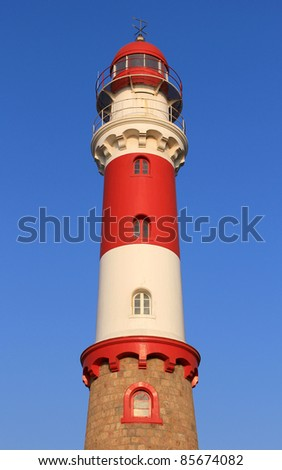 Famous Lighthouse in Swakopmund, a germam style colonial city on the Atlantic coast of northwestern Namibia - stock photo