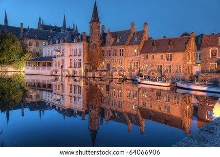 Famous location in Bruges, Belgium, the rozenhoedkaai, at night - stock photo