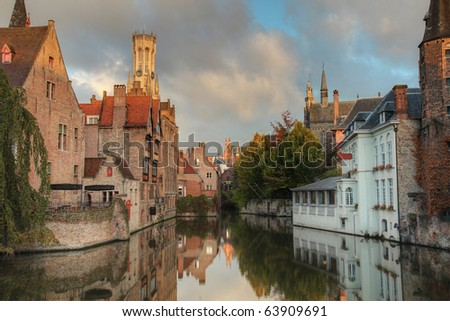 Famous location in Bruges, Belgium, the rozenhoedkaai, in early morning light at sunset