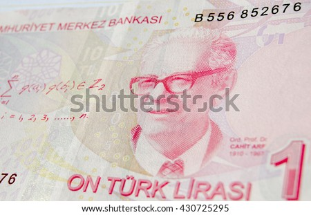 Famous mathematician Professor Dr Cahit Arf on a ten Lira banknote in circulation in Turkey.  He is famous for work leading to knot theory and surgery theory.  Used banknote, photographed at an angle. - stock photo