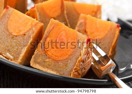 Famous moon cake with assorted nuts and egg yolk - stock photo