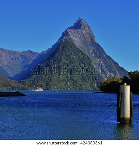 Famous mountain Mitre Peak. Milford Sound, New Zealand. Popular travel destination. - stock photo