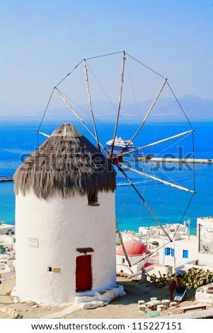 Famous Mykonos Windmill -windmill overlooking the town of Mykonos Greece - stock photo