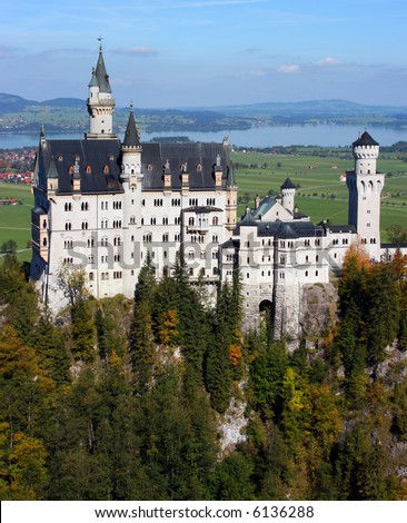 Famous Neuschwanstein castle in autumn on a clear sunny day, Bavaria Germany - stock photo