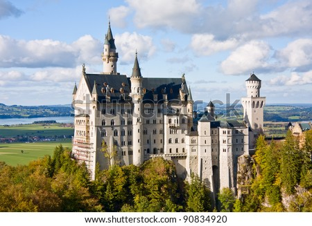 Famous Neuschwanstein castle in Germany, Bavaria, built by King Ludwig II in 19th-century - stock photo