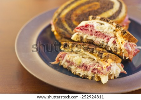 Famous New York Reuben corned beef sanwich with chips and a pickle - stock photo