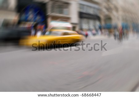 Famous New York yellow taxi cabs in motion - intentional blur - stock photo