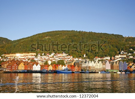 Famous Norwegian city Bergen and its harbor in warm evening sunlight