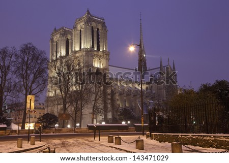 Famous Notre Dame de Paris Cathedral in Paris in the Evening - stock photo