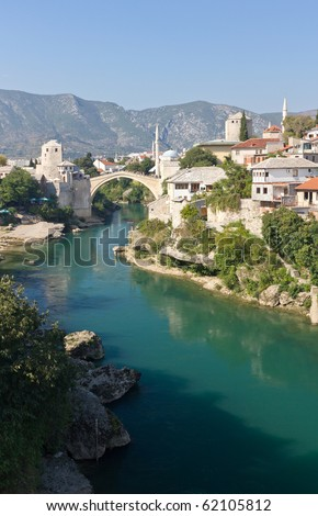 Famous Old Bridge on the Neretva River in Mostar, Bosnia and Herzegovina - stock photo