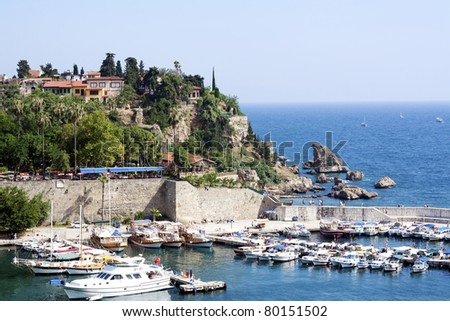 Famous old harbor in Antalya with boats, ships and yachts anchored in it. - stock photo