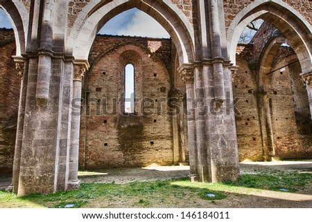 Famous Open Abbey of San Galgano, Tuscany, on a Spring Day. - stock photo