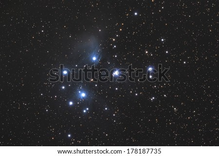 Famous Pleiades nebula in zodiac constellation of the Bull.  - stock photo