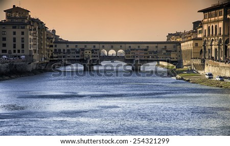 Famous Ponte Vecchio over Arno river in Florence, Italy - stock photo