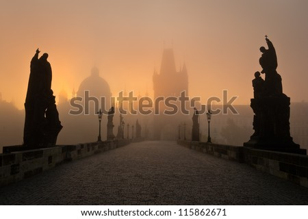 Famous Prague Charles bridge in misty morning - stock photo