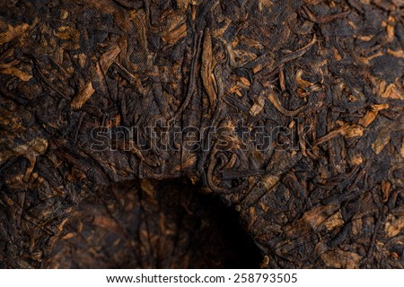 famous pressed ripe Puer tea in Chinese cake closeup - stock photo