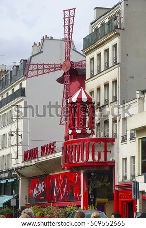 Famous red mill at Moulin Rouge cabaret in Paris - a tourist attraction - PARIS / FRANCE - SEPTEMBER 25, 2016