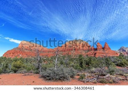 Famous Red Rock Country near Sedona, Arizona. Panoramic vistas. Biking, hiking, and walking trails. Climbing cliffs. Beautiful sunrises and sunsets. Unsurpassed Southwestern landscape colors. - stock photo