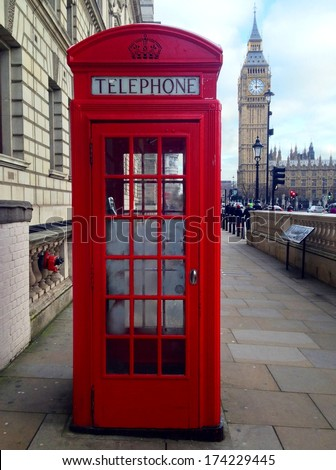 Famous Red Telephone Booth, Big Ben and Houses of Parliament in London, UK.  - stock photo