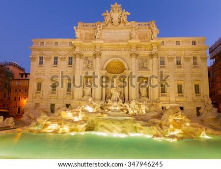 famous restored Fountain di Trevi in Rome at night, Italy - stock photo