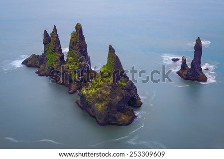 Famous Reynisdrangar cliffs at south coast of Iceland - stock photo