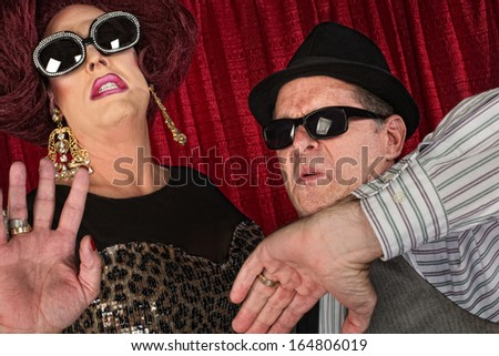 Famous 1960s retro style couple in sunglasses - stock photo