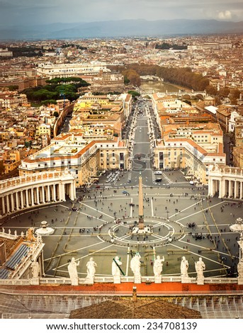 Famous Saint Peter's Square in Vatican and aerial view of the city, Rome, Italy. - stock photo