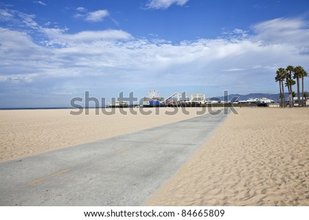 Famous Santa Monica beach bike path and amusement pier. - stock photo