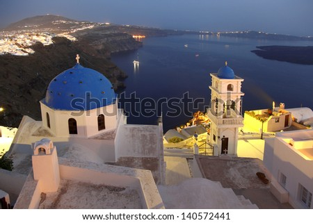 Famous Santorini in the evening with churches, Greece - stock photo