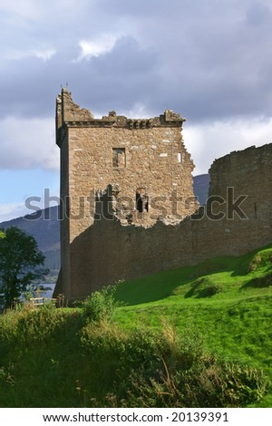 famous scottisch urquhart castle at  loch ness on a hill - stock photo