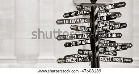 Famous signpost with directions to world landmarks in Pioneer Courthouse Square, Portland, Oregon - stock photo