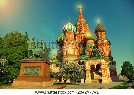 Famous St. Basil's Cathedral in Moscow, and a statue of Minin and Pozharsky on Red Square, Russia - stock photo