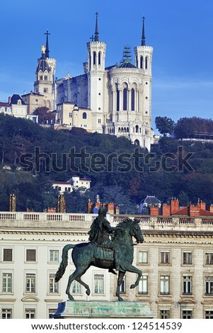 famous statue and Fourviere basilic on a background - stock photo